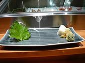 匠壽司日式料理:盤架與醃漬蘿蔔